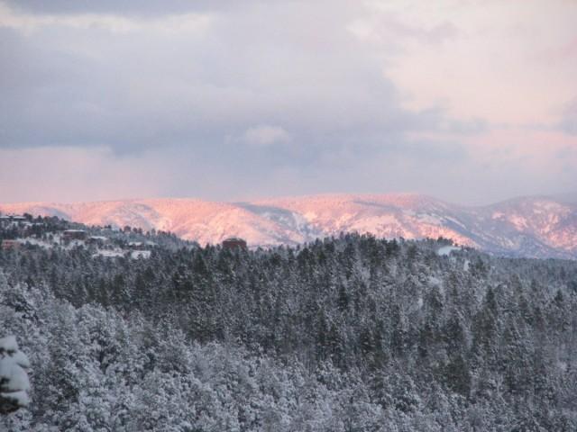 Snow, clouds, & sunglow
